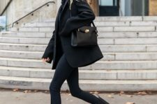 08 a total black outfit with a hoodie, skinnies, chunky boots, a short coat and a black bag