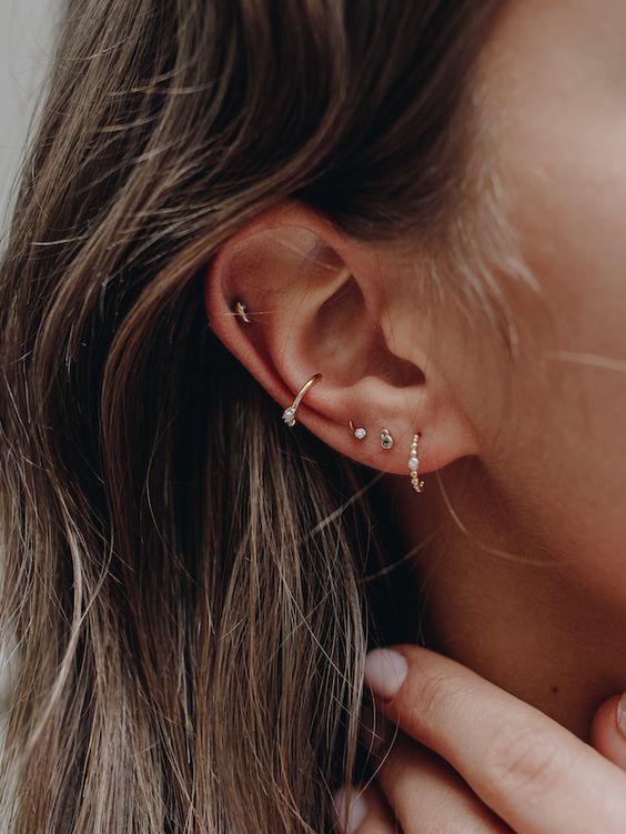 mini embellished hoop earrings combined with mini embellished studs for a cool stacked earring look