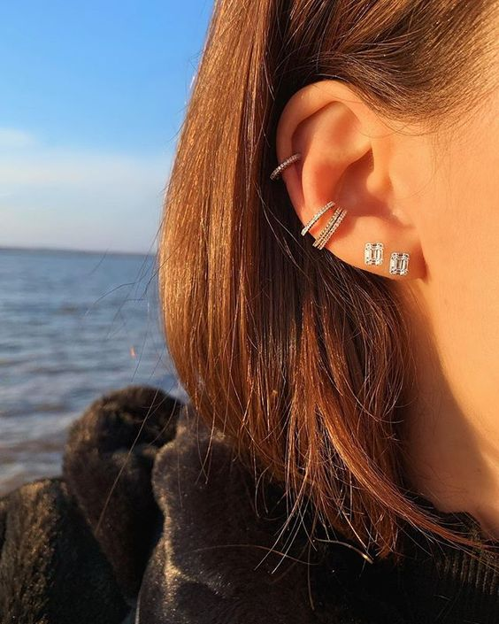 a duo of embellished cuffs and a matching earring plus two studs make the look super bold