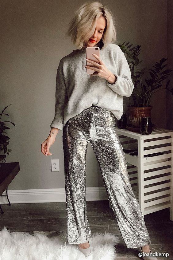 a grey oversized cashmere sweater, silver sequin pants and neutral shoes for a minimal chic look
