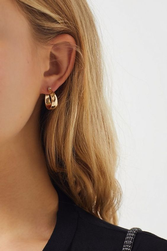a chunky gold hoop earring will make a statement in your look giving it a bit of retro feel at the same time