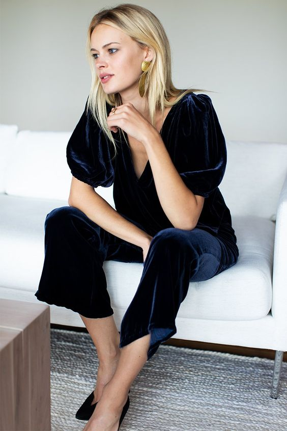 a navy velvet jumpsuit with cropped pants, puff sleeves and a deep V-neckline is all you need to look wow