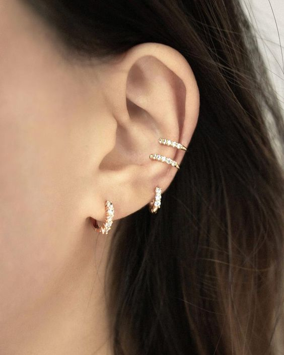 a set of beautiful diamond earrings and ear cuffs looks really cool and makes you super shiny and bright