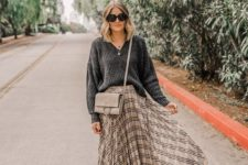 11 a comfy look with an oversized grey sweater, a neutral pleated plaid midi, black boots and a grey bag