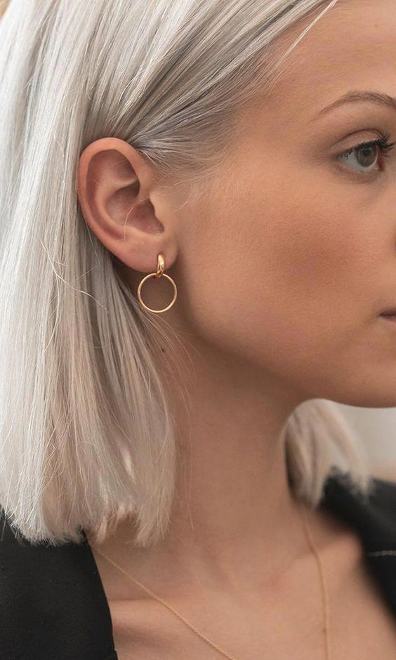 a gold hoop and circle earring will add a bright and catchy modern touch to your outfit