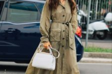11 a green midi shirtdress with pockets, blakc chunky boots and a white bag for a bold look
