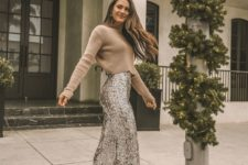 11 a tan cropped sweater and high waisted silver sequin fit and flare pants for a 70s inspired holiday look