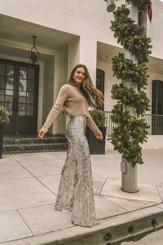 a tan cropped sweater and high waisted silver sequin fit and flare pants for a 70s inspired holiday look