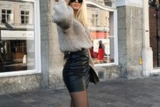 12 a black leather mini skirt, a grey chunky knit sweater, black tights and cool boots with belts