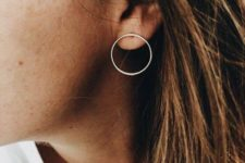 12 a non-traditional minimalist hoop earring that is placed in your ear in a different way