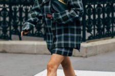 12 a plaid suit with a mini skirt and an oversized blazer, a black clutch and chunky boots for a trendy look
