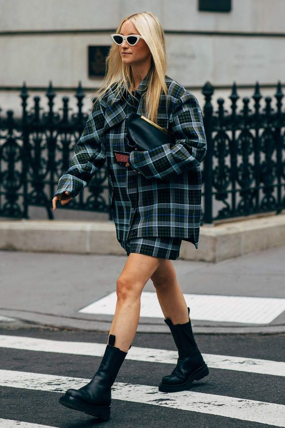 a plaid suit with a mini skirt and an oversized blazer, a black clutch and chunky boots for a trendy look