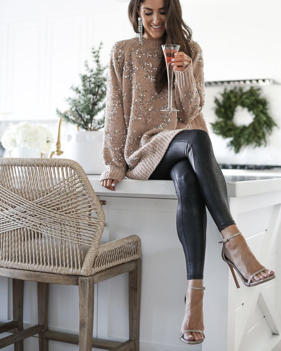 a tan embellished sweater, black leather leggings and tan shoes for a chic statement look