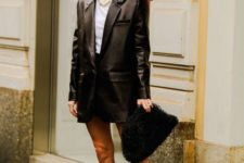 13 a quirky look with a white tee, a black mini, an oversized black leather jacket, a fluffy clutch and chunky boots
