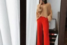13 a tan oversized sweater, red palazzo pants and tan shoes for a minimal yet bright look