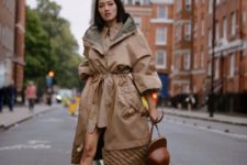 14 a tan colored shirtdress, a matching grey and tan parka, black chunky boots and a quirky brown bag