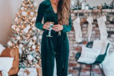14 a teal velvet jumpsuit with a V-neckline and long sleeves is a chic and stylish outfit to go for these holidays
