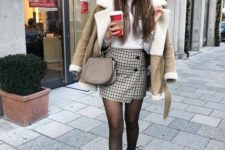 14 a white top, a tweed mini skirt with buttons, a neutral shearling coat, a tan bag on a ring, black boots