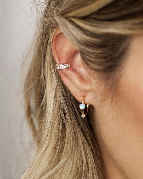 an embellished statement ear cuff plus a moonstone earring for a chic boho-inspired look