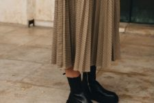 15 a vintage-infused look with a plaid pleated midi, a white shirt and black chunky boots