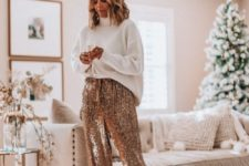 15 a white oversized turtleneck sweater, rose gold sequin pants, tan shoes for a minimal holiday look