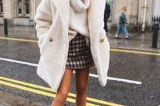 15 an oversized white chunky knit sweater, a tweed mini skirt, a white faux fur coat and white booties