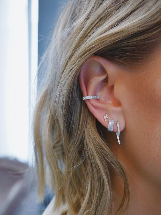 diamond earrings and a matching cuff to make the ear even bolder and even more chic