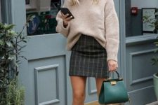 16 a neutral sweater, a grey plaid mini skirt, tan boots and an emerald bag for fall or winter