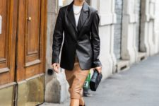 16 an edgy look with a white tee, a black leather jacket, a tan leather midi, chunky boots and a black clutch