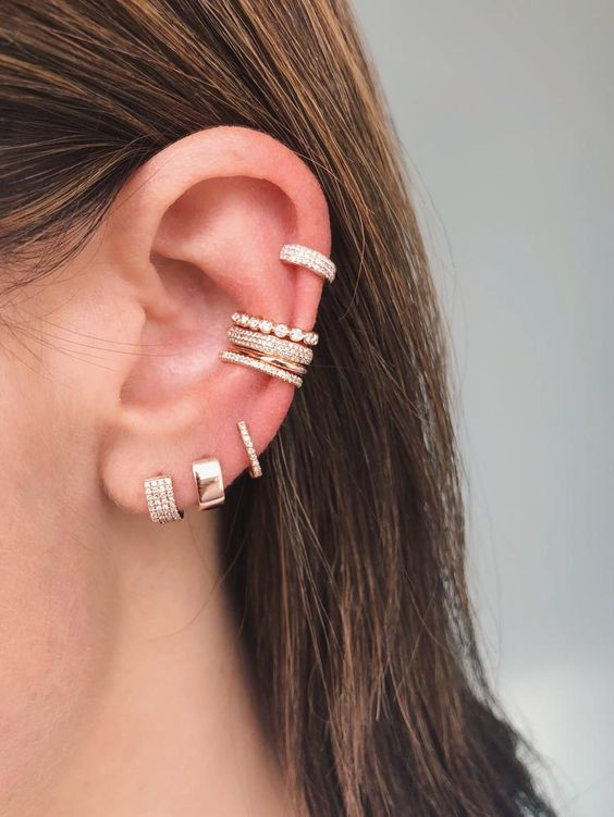 four embellished ear cuffs combined  with matching diamond earrings will make your look ultimate