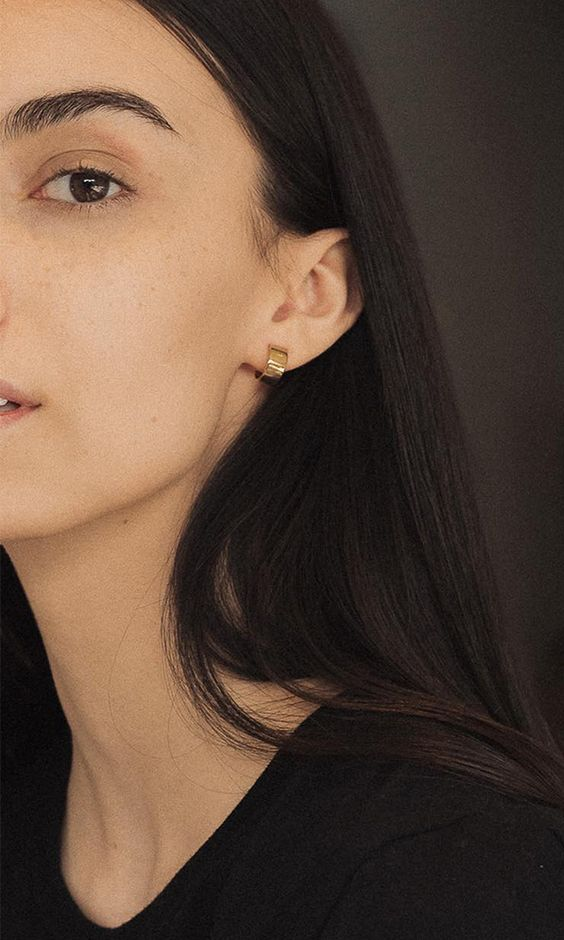 very thick yet small gold hoop earrings look rather modern and statement like, despite their size