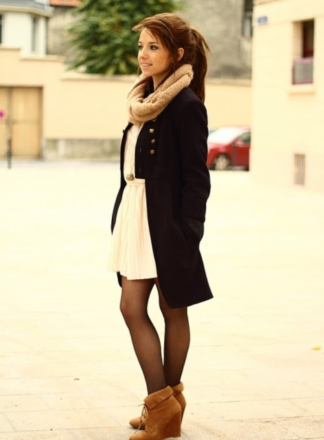 With beige dress, black coat and scarf