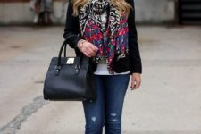 With black blazer, jeans, red shoes, white t-shirt and black bag