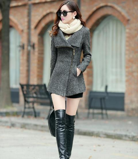 With black dress, beige scarf, black bag and black over the knee boots