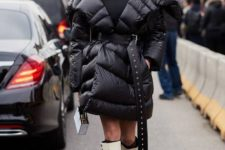 With black fitted dress, mini bag and white and black high boots