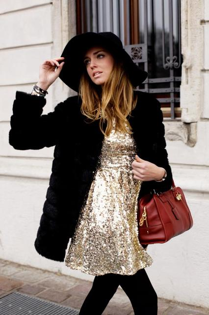 With black fur jacket, black hat and red bag