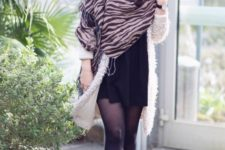 With black hat, black mini dress, brown high boots and white cardigan