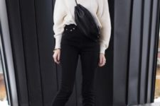 With black high-waisted pants, black bag and sneakers