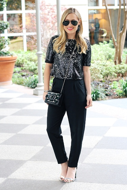 With black high-waisted pants, chain strap bag and silver shoes