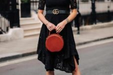 With black lace dress, belt and black ankle boots