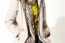 With black leather pants, yellow shirt and white puffer coat