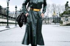 With black leather platform high boots and black bag