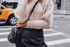 With black leather skirt and black embellished bag
