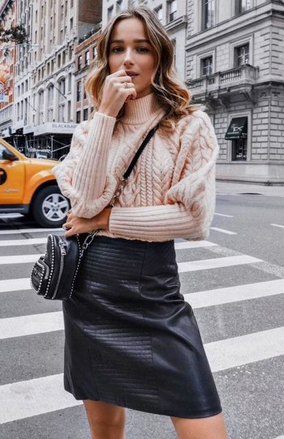 With black leather skirt and black embellished bag