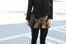 With black loose shirt, black clutch, black tights and black ankle boots