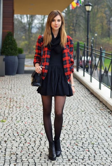 With black mini dress, black scarf, black bag and ankle boots