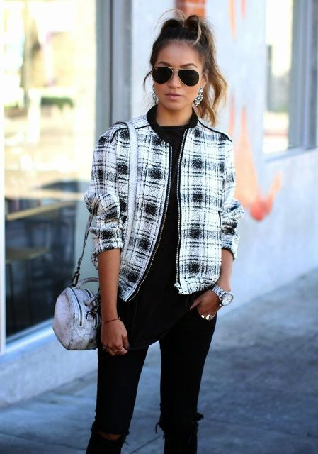 With black shirt, black pants and silver bag