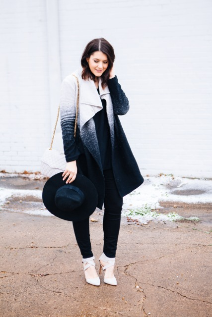 With black shirt, black pants, wide brim hat, chain strap bag and lace up high heels