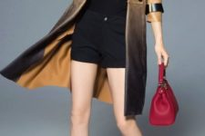 With black shorts, black shirt, red bag and black pumps