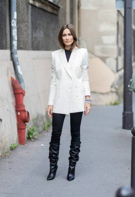 With black t-shirt, white long blazer and black pants